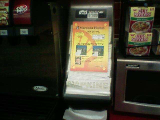 Napkin dispenser advertising